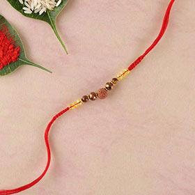 Rudraksh, Crystal & Agate Rakhi in Flat Woven Red Thread