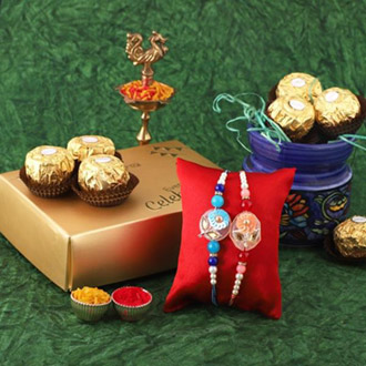 Sequins Rakhi Pair & 12pc Ferrero
