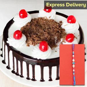 Auspicious Rakhi and tasty cake