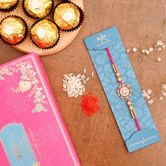 American Diamond Floral Rakhi And 3 Pcs Ferrero Rocher - Rakhi to Qatar