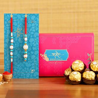 Blue Pearl And Lumba Rakhi Set With 3 Pcs Ferrero Rocher