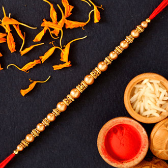 Traditional Pearl And Mauli Rakhi