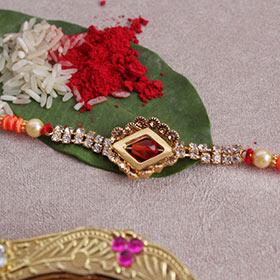Beautiful Stone Studded Golden Rakhi