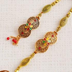 Enticing Golden Bhaiya Bhabhi Rakhi Set