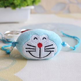 Cute & Soft Doraemon Rakhi - Turquoise Colour Rakhi