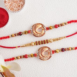 Splendid set of 3 divine golden Rakhi