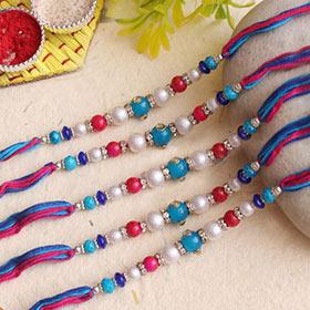 Gorgeous pearls stone Rakhi set of 5 - Blue Colour Rakhi