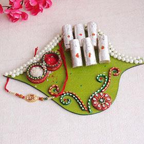 Captivating Om Rakhi with Sweets: & Thali