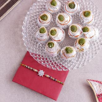 Scintillating Pearl Rakhi with Kaju Kalash Sweets