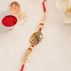 Antique Golden Rakhi with Pearls - Zari Rakhi