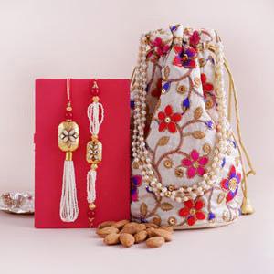 Designer Bhaiya Bhabhi Rakhi with Almond Potli - White Colour Rakhi