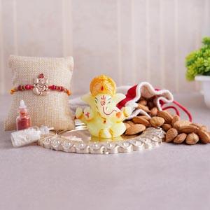 Ganesha Rakhi With Almonds and Puja Thali Combo