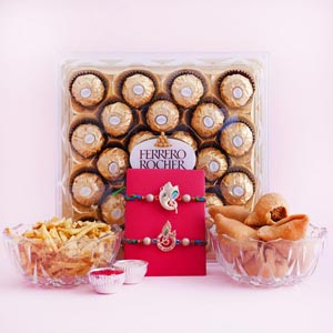 Two Auspicious Golden Rakhi with Sweets and Snacks