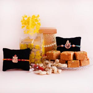 Auspicious Rakhi with  Dryfruits and Sweets Hamper