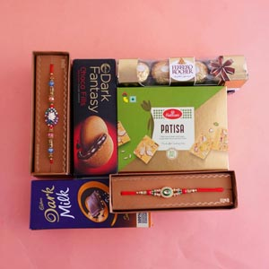 Two Designer Rakhi with Sweets and Chocolates