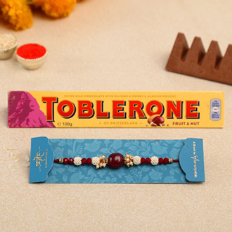 Red Beads Pearl Designer Rakhi And Toblerone Chocolate