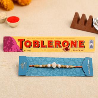 Elegant Pearl Mauli Rakhi And Toblerone Chocolate