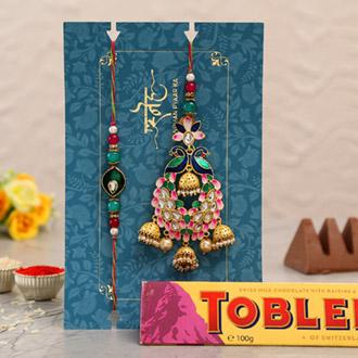 Pink Peacock Lumba Rakhi Set With Toblerone Chocolate