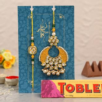 Yellow Crescent Shaped Lumba Rakhi Set With Toblerone Chocolate