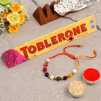 Navrattan Bracelet Pearl Rakhi And Toblerone Chocolate