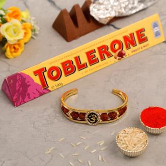 Om And Rudraksha Bracelet Rakhi With Toblerone Chocolate