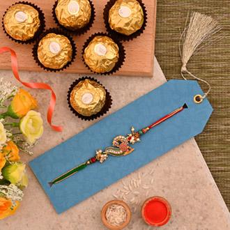 Beautiful Peacock Designer Rakhi And 3 Pcs Ferrero Rocher
