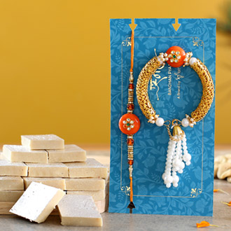 Orange Pearl And Lumba Rakhi Set With Kaju Katli