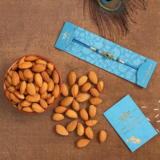 Circular Peacock Feather Rakhi And Healthy Almonds