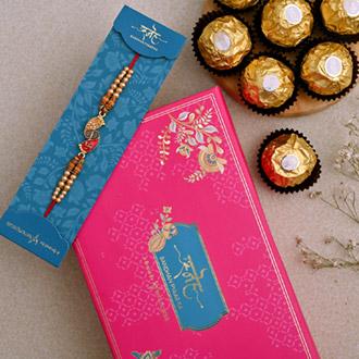 Divine Swastik Paduka Rakhi And 3 Pcs Ferrero Rocher