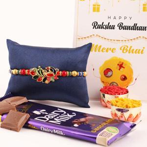 Elegant Peacock Rakhi and Cadbury