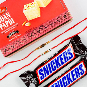 White Golden Pearl Set of 2 Rakhis With Soan Papdi & Snickers